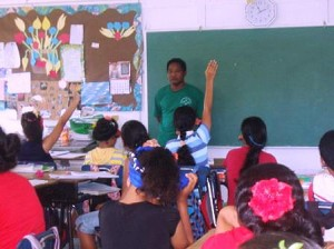 4-H Extension Agent, Martin Ruwniyol in the classroom giving a lecture on nutrition.